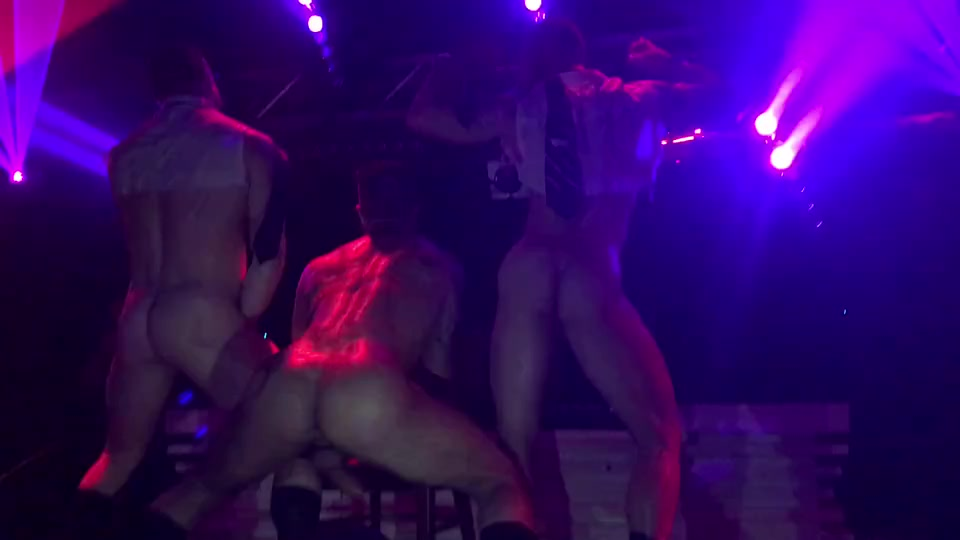 Three muscle hunks dance on stage naked