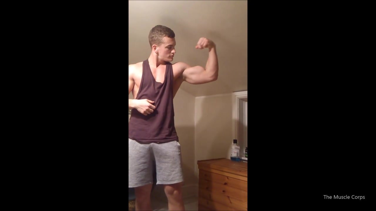 Young muscular guy flexing and showing off his body