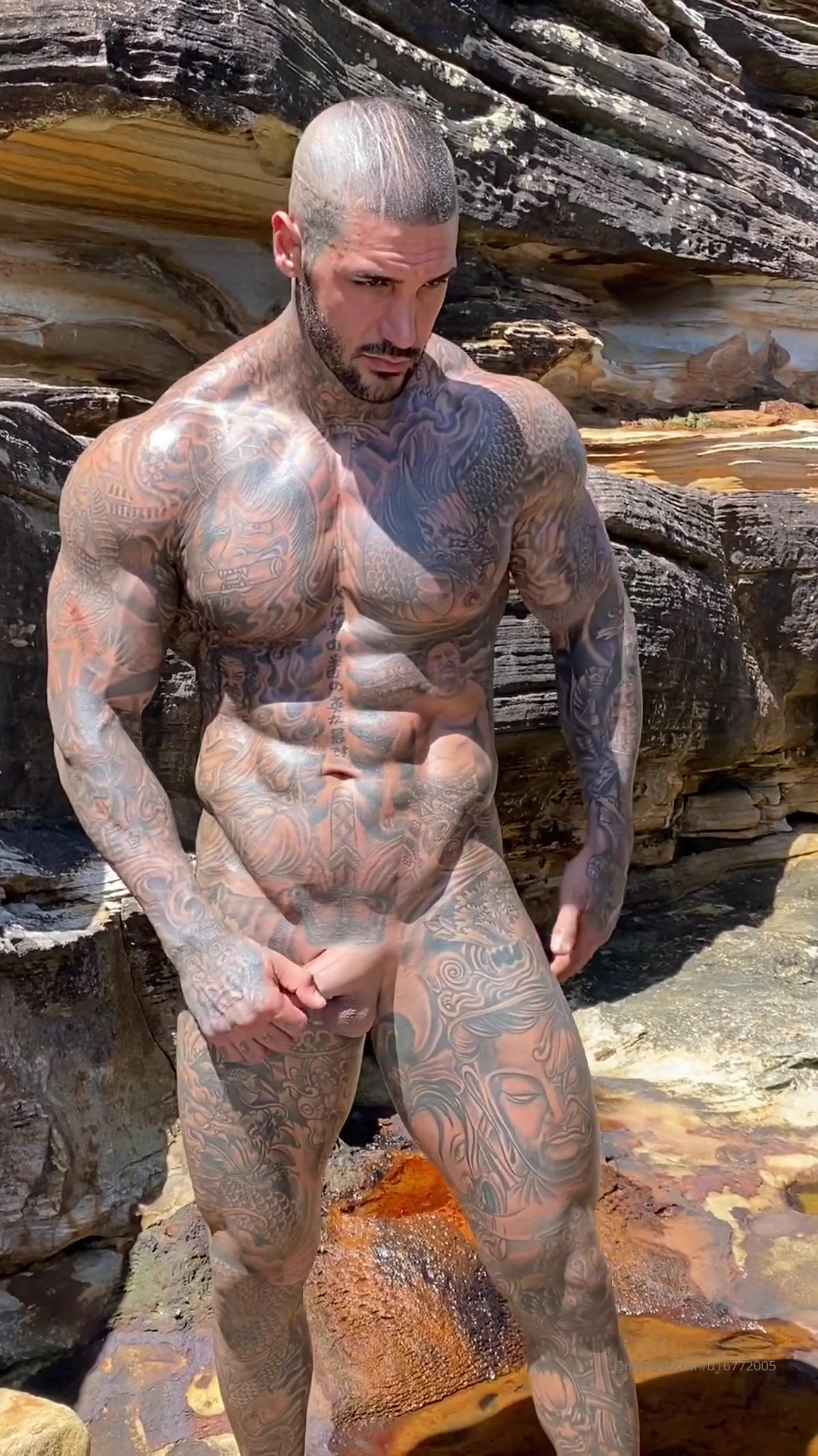 Hot Muslim guy covered in tattoos showing off his body and cock at the beach