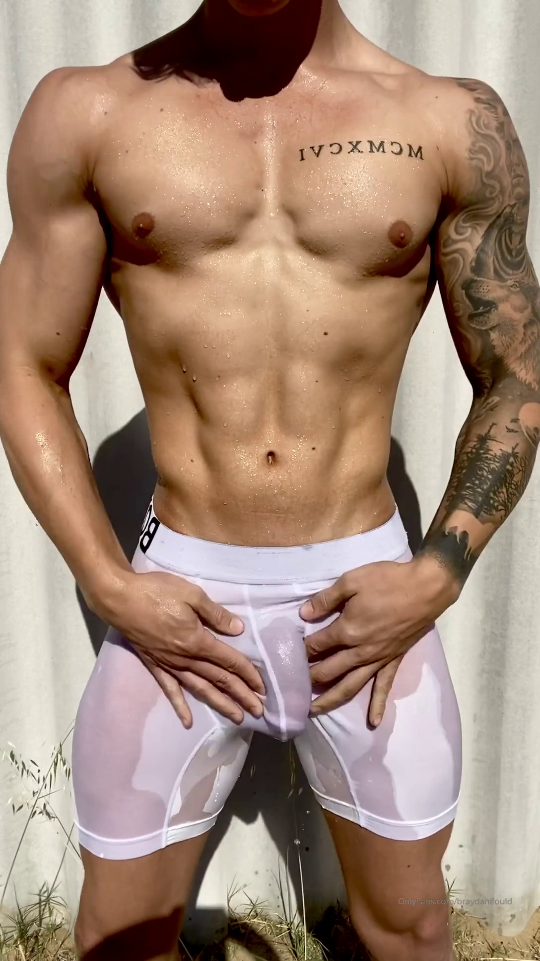 Hot Australian covering himself in water
