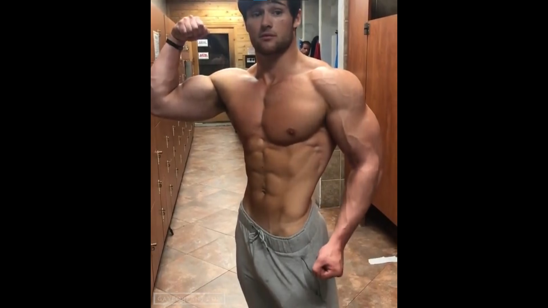 Dylan McKenna flexing at gym