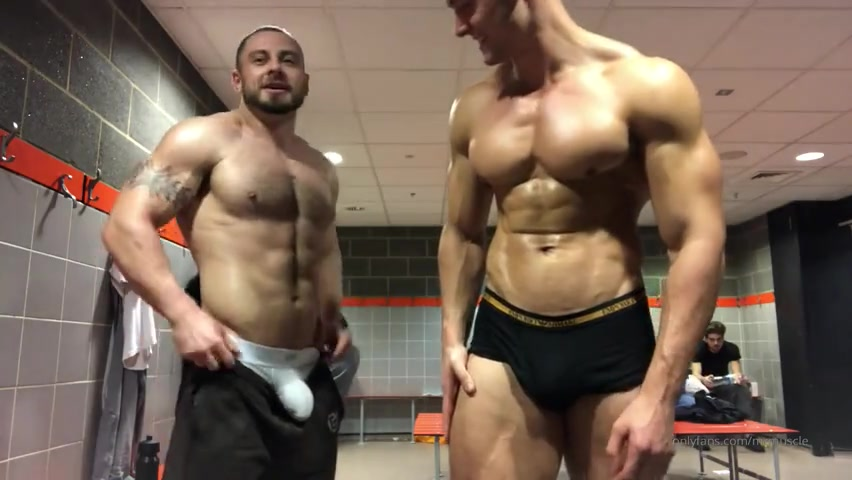Flexing in the gym change room with a mate - MrMuscle