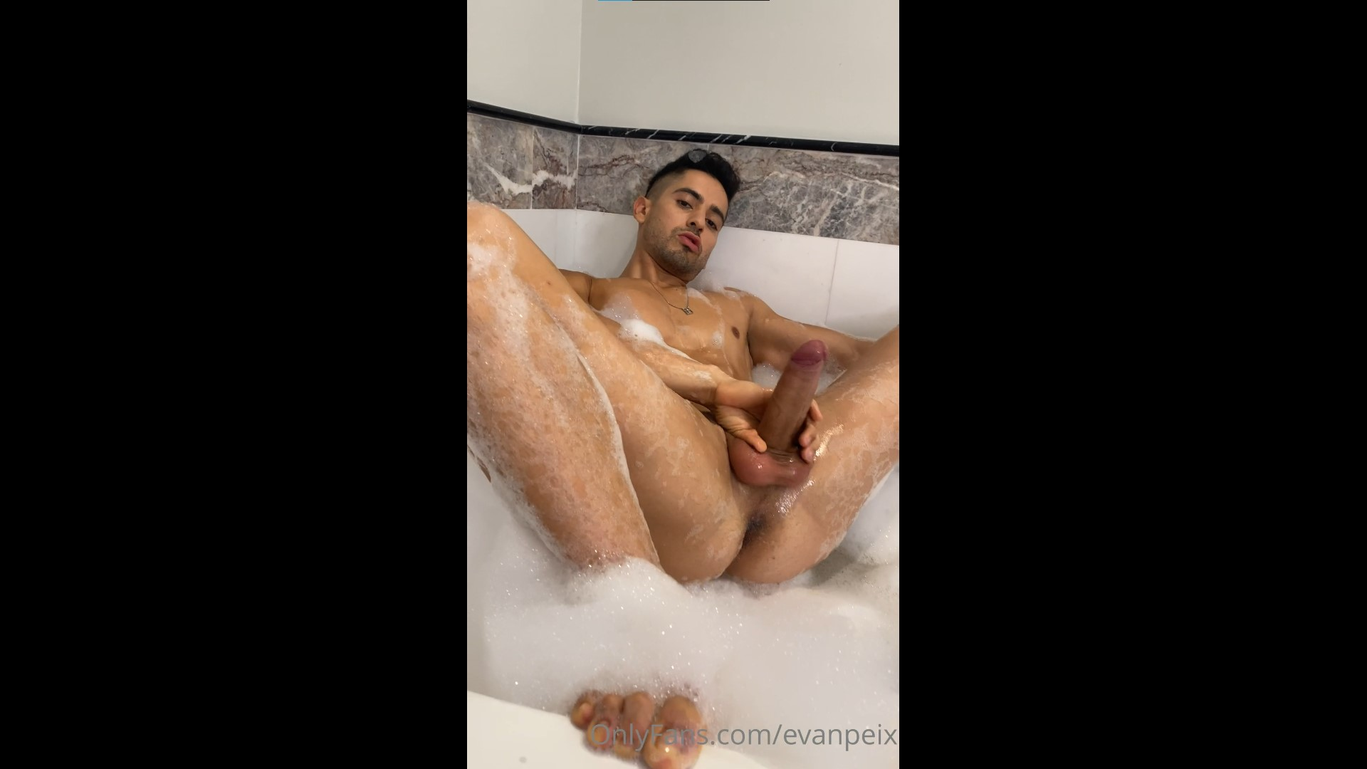 Evan Peix fooling around in the bath