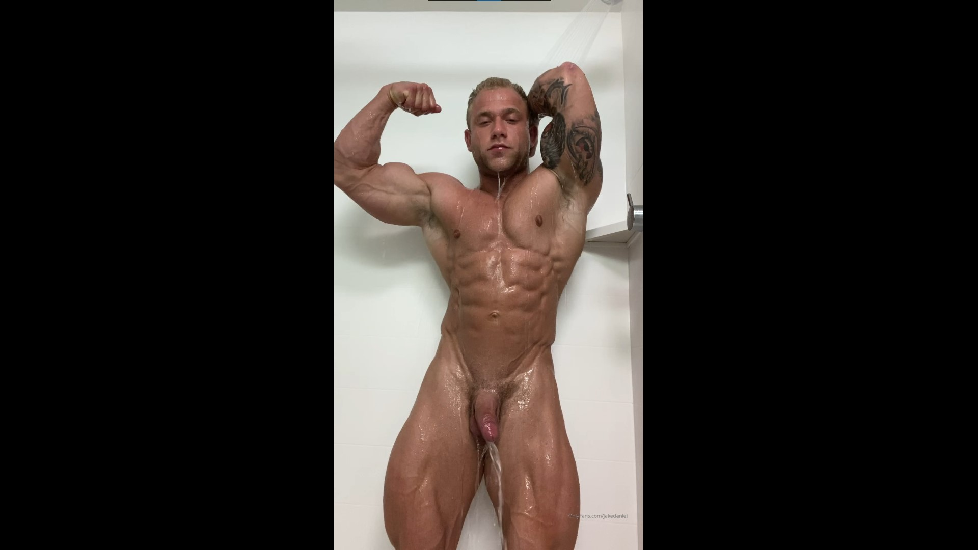 Flexing while in the shower - Jake Daniel